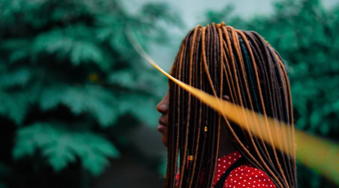 profile of a woman with dreadlocks